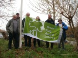 Bidston Hill's Friday Group raising the Green Flag Award.