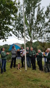 Mayor Ann McLachlan raising Bidston Hill's Green Flag